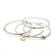 SET OF FOUR 9CT GOLD & SILVER BANGLES